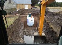 An excavator digging out a deep hole